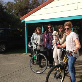 Happy guests after morning cycle-with dog